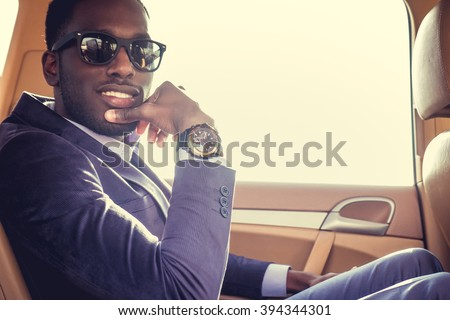Stylish black man in the car. - stock photo