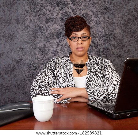 Stylish black woman at home with a laptop, phone and coffee cup working or shopping online part of a set - stock photo