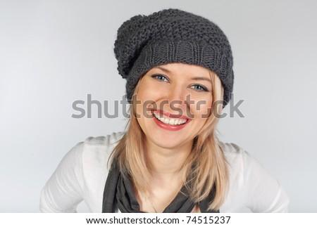 Stylish blonde girl wearing winter wool hat - stock photo