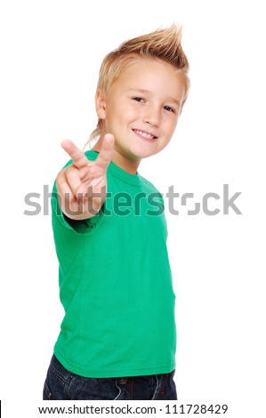 Stylish boy in green tshirt making a victory sign - stock photo