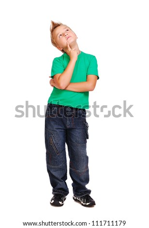 Stylish boy in green tshirt over white background full length looking up - stock photo