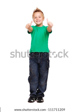 Stylish boy in green tshirt over white background full length showing thumbs up - stock photo