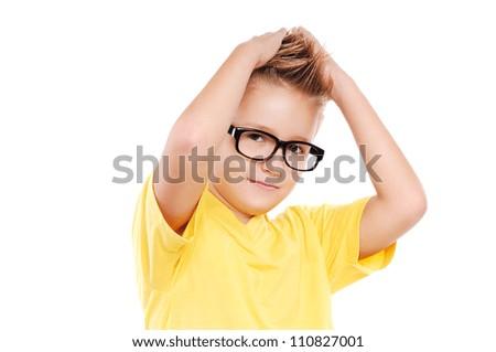 Stylish boy making a mohawk hairstyle to himself - stock photo