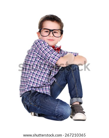 stylish boy standing on his knee on white background - stock photo