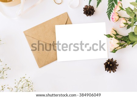 Stylish branding mockup with flowers to display your artworks. Cute vintage mock up on wooden background. - stock photo