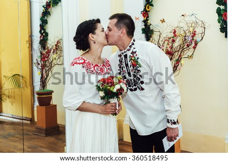 stylish bride and groom kissing, traditional wedding ceremony