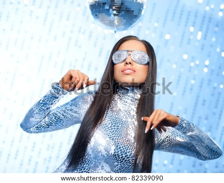 Stylish brunette in a club - stock photo