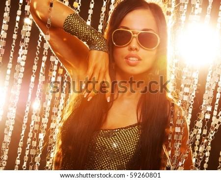 Stylish brunette in the nightclub - stock photo