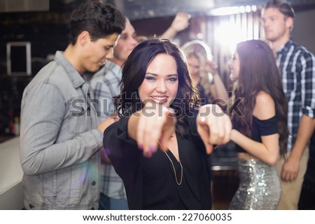Stylish brunette smiling and dancing at the bar - stock photo