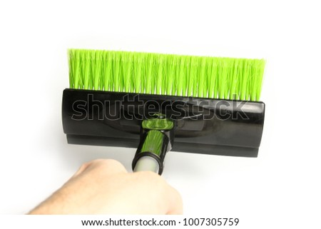 stylish brush in hand for car winter snow on a white background