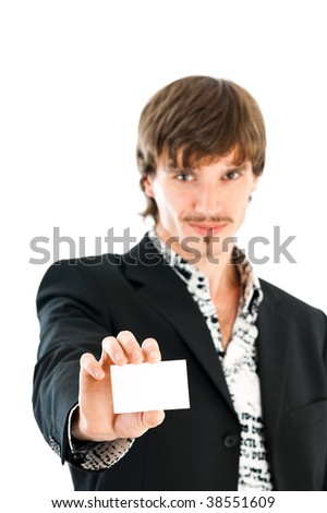 Stylish business man handing a blank business card over white background - stock photo