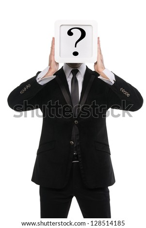 Stylish business man holding a white square box over his face with a question mark on it. Isolated on white background. - stock photo