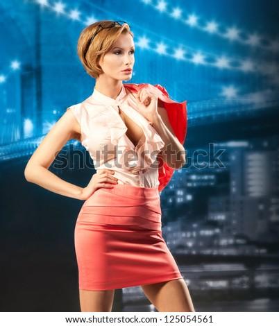 Stylish business woman in night city - stock photo