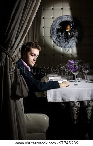 Stylish businessman at the restaurant for a business lunch - stock photo