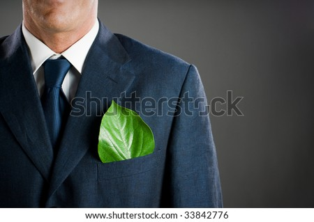 Stylish businessman with a fresh green leaf in his pocket. Green business concept, take care of the environment! - stock photo