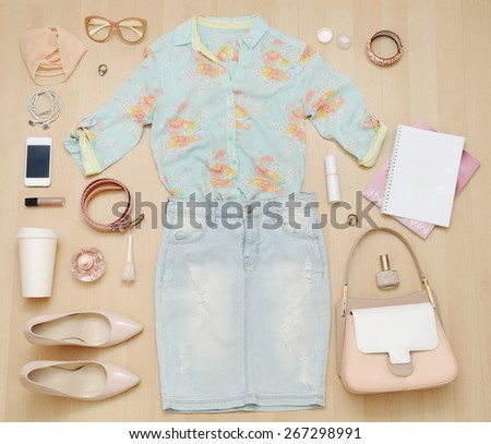 stylish casual set of clothes and accessories and stuff for urban woman in soft colors, fashion concept  - stock photo