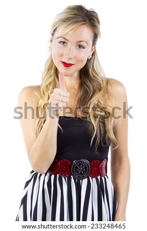 stylish caucasian female with thumbs up hand gesture on white background - stock photo