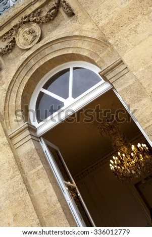 Stylish chandelier and stone facade of a French mansion in Bordeaux