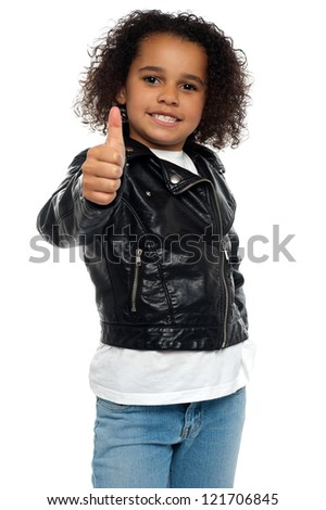 Stylish child savoring sweet success by gesturing thumbs up. - stock photo