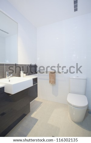 Stylish clean bathroom and toilet - stock photo