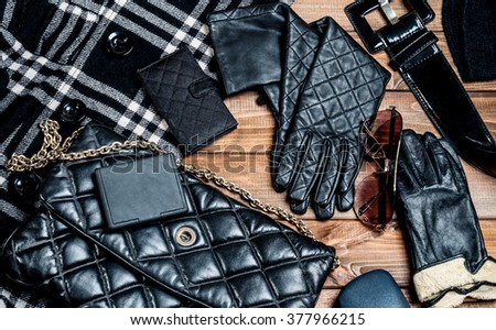 Stylish clothes and accessories on wooden boards - stock photo