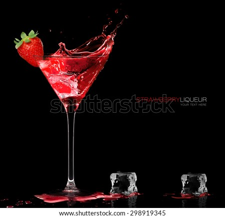 Stylish cocktail glass with red liquor splashing out, garnished with a ripe fresh strawberry, closeup isolated on black with sample text. Party concept. Template design. - stock photo