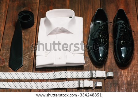 stylish collection of men's clothing. Black tie , patent leather shoes , suspenders, a white shirt - wedding set for the groom . top view. - stock photo