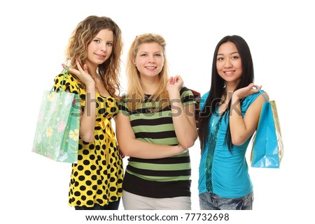 Stylish college girls with shopping bags - stock photo