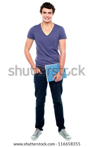 Stylish college student posing with notebook in one hand and other hand in  pocket - stock photo