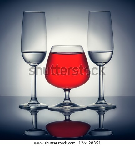 Stylish composition of three glasses of champagne and cognac - stock photo