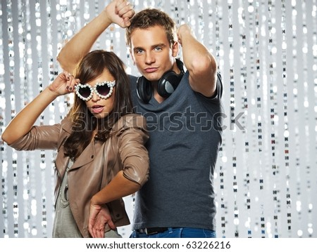 Stylish couple dancing in the nightclub