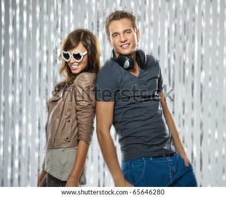 Stylish couple dancing in the nightclub - stock photo