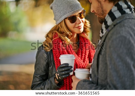 Stylish couple with drinks - stock photo