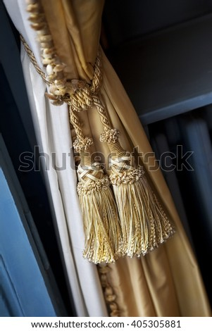 Stylish curtain and trimmings in a French house - stock photo