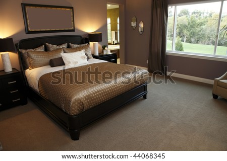 Stylish designer bedroom with contemporary furniture. - stock photo