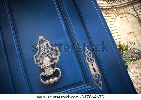Stylish door knocker of an old French mansion in Bordeaux - stock photo