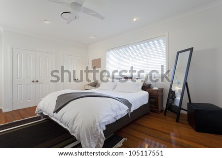 Stylish double bedroom in modern Australian home - stock photo