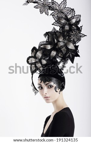 Stylish Eccentric Woman with Fanciful Make-up and Outlandish Hat - stock photo