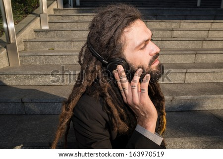 Stylish elegant dreadlocks businessman in business landscape