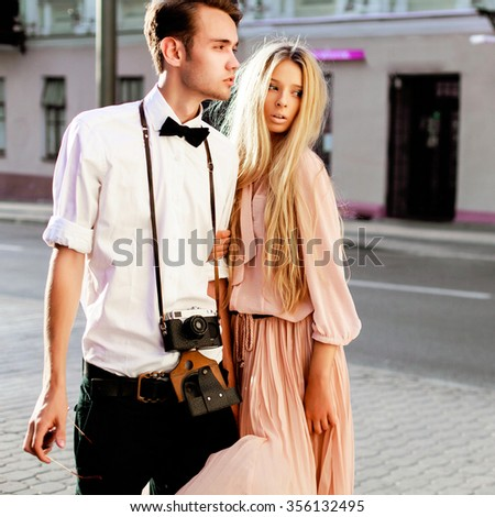 Stylish fashion hipster style couple posing outdoor on the street