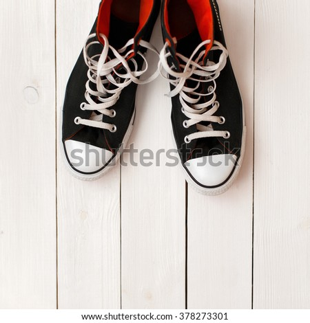 Stylish fashionable black shoes on a white wooden background - stock photo