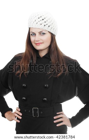 Stylish fashionable young woman in white knitted hat and black coat isolated on white - stock photo