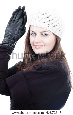Stylish fashionable young woman in white knitted hat and black leather gloves isolated on white - stock photo