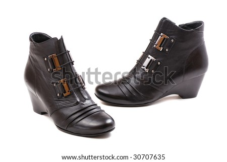 Stylish female boots of black colour of graceful modern design.