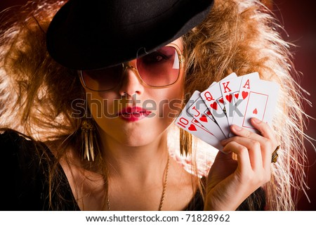 Stylish female poker player holding a royal flush