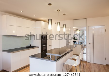 Stylish flat - Interior of modern and bright kitchen - stock photo
