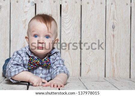 stylish funny little boy in bow tie - stock photo