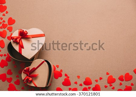 Stylish gifts with red ribbons copyspace.