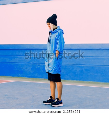 Stylish Girl in bright blue coat in blue location Blue color in trend - stock photo