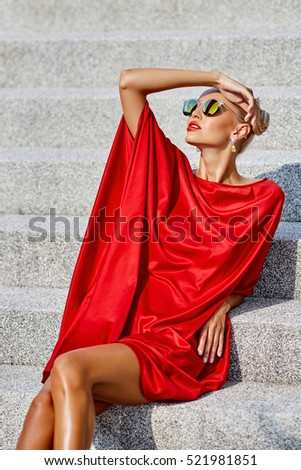 Stylish girl in red dress outdoor fashion portrait